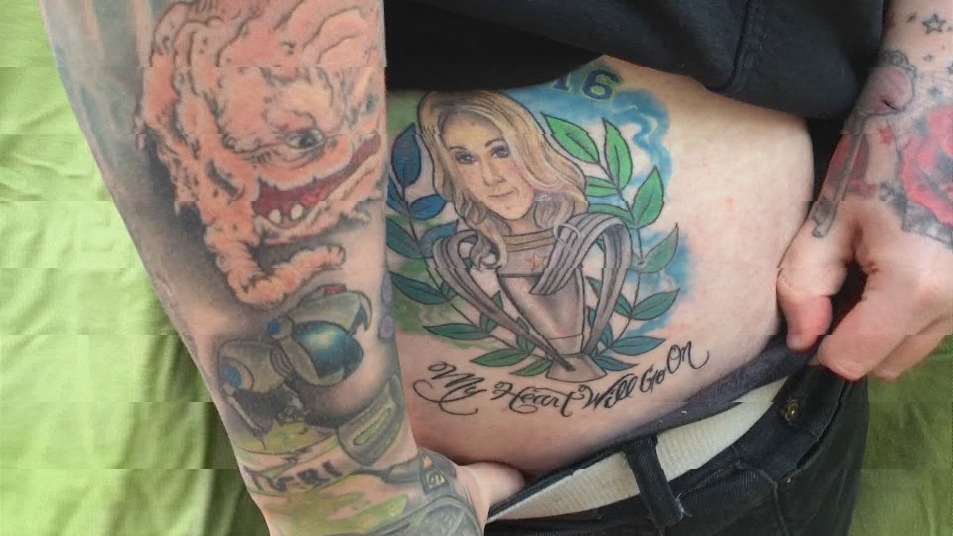 Sounders fan wears heart on sleeve and buttock for Seattle sounders tattoo