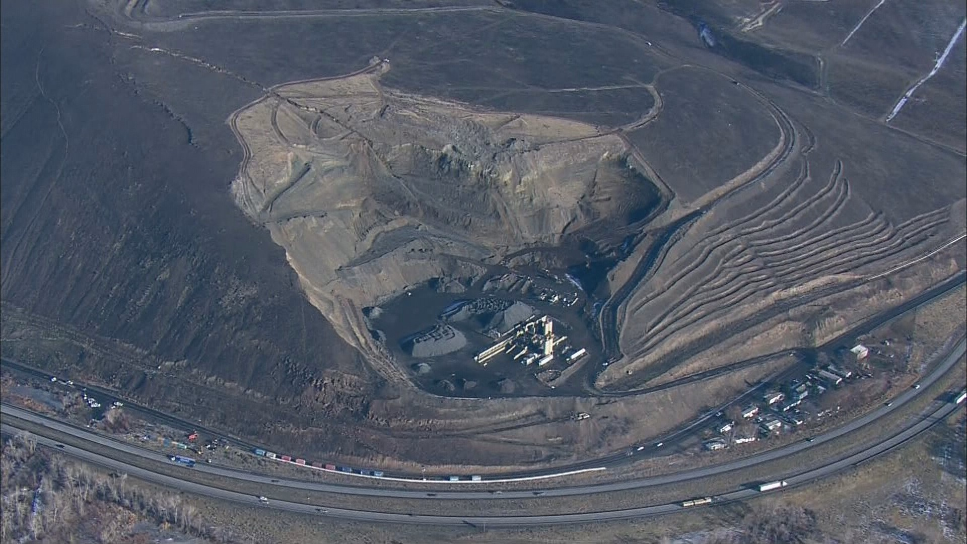 "One possibility as to what's behind the landslide at Rattlesnake Ridge is the quarry at the base of the hill. Geologists say it could undermine the ""toe"" of the slope. (Credit: KING)"